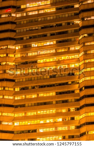 Beautiful exterior building and architecture of building with window and light pattern at night #1245797155