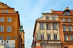 Beautiful facades of the historic edifices in the Old Town (Stare Miasto), Castle Square, Warsaw, Poland.