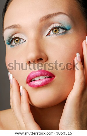 Beautiful face. Blue make-up for eyes. Green eyes.