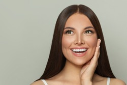Beautiful face. Healthy spa model woman with clear skin and long healthy straight hair. Skincare and facial treatment concept