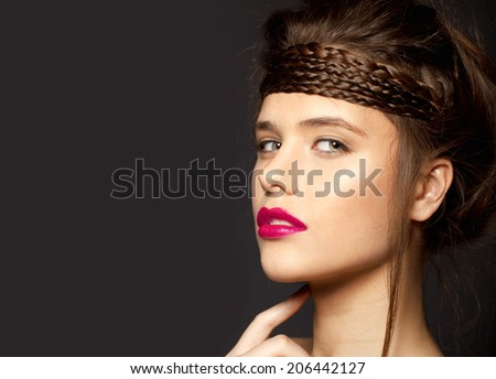 Beautiful face of a glamour woman with pink lips. studio shot and shine hair