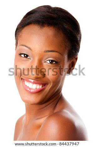 Beautiful face of a happy attractive African young woman smiling with healthy pimple acne free skin and white teeth, skincare or dental care concept, isolated.