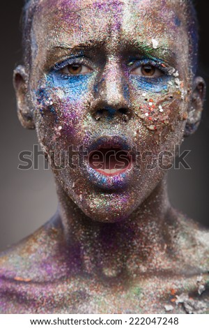 Beautiful Face Of A Woman With Art And Covered In Glitter Close Up