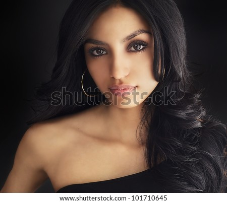 Beautiful face of dark haired young woman