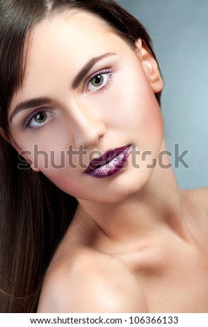 Beautiful face of the teenager girl with bright fashion make-up