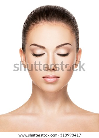 Beautiful face of young caucasian woman with health fresh skin  - isolated on white.  Closed eyes #318998417