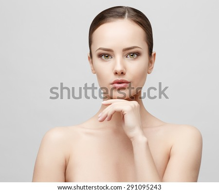 Beautiful Face of Young Woman with Clean Fresh Skin close up isolated on white. Beauty Portrait. Beautiful Spa Woman Smiling. Perfect Fresh Skin. Pure Beauty Model. Youth and Skin Care Concept