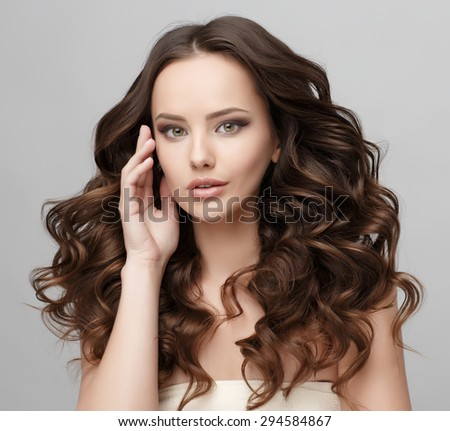 Beautiful Face of Young Woman with Clean Fresh Skin close up isolated on white. Beauty Portrait. Beautiful Spa Woman Smiling. Perfect Fresh Skin. Pure Beauty Model. Youth and Skin Care Concept #294584867