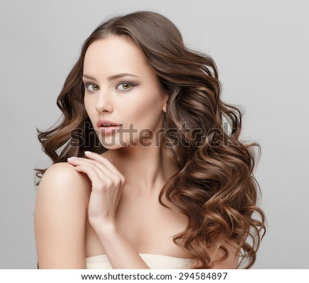 Beautiful Face of Young Woman with Clean Fresh Skin close up isolated on white. Beauty Portrait. Beautiful Spa Woman Smiling. Perfect Fresh Skin. Pure Beauty Model. Youth and Skin Care Concept #294584897
