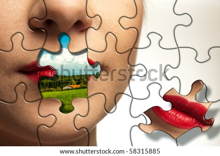 Beautiful face of young woman with puzzle pieces. Landscape with blue sky on a place of lips.