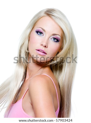 Beautiful face with saturated colors of make-up and straight long hair