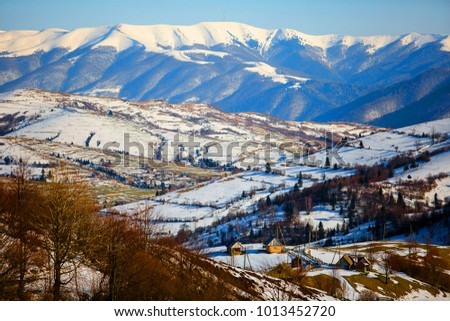 Beautiful fairy view of the mountain in winter in the village #1013452720
