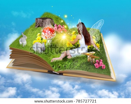 Beautiful fairytale book with magic fairy and decoration #785727721
