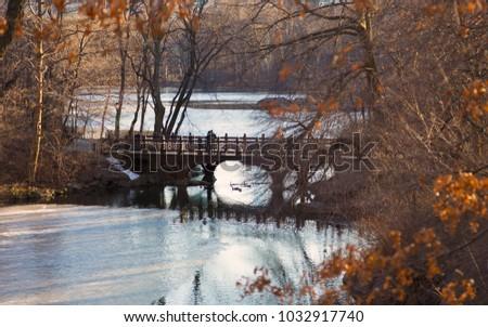 Beautiful Fall colors at Oak Bridge ,Bank Rock bay, Central Park, New York City, USA