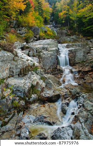 Beautiful fall foliage at the Flume Cascade. Crawford Notch State Park, White Mountains, New Hampshire