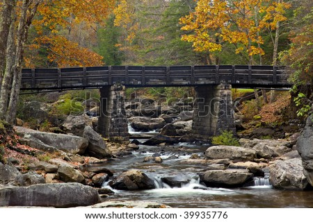 Beautiful Fall view of Glade Creek Bridge and Creek in Babcock State Park, West Virginia, USA