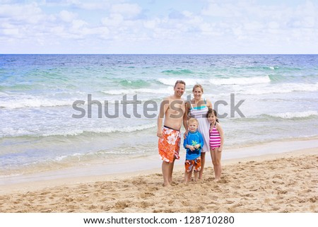 Beautiful Family enjoying a day at the beach