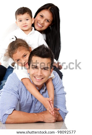 Beautiful family lying down - isolated over a white background