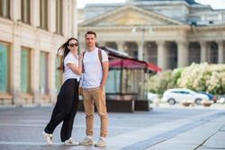 Beautiful family outdoors on background of Kazan Cathedral in Saint Petersburg