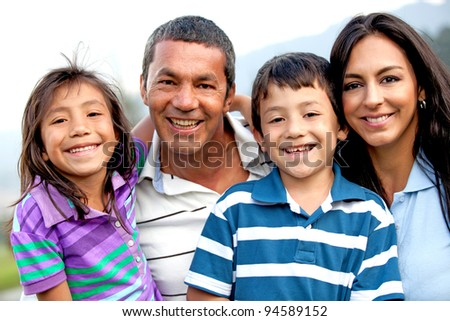 Beautiful family portrait looking happy and smiling outdoors
