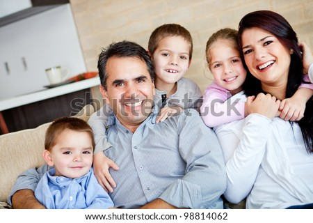 Beautiful family portrait relaxing at the living room at home