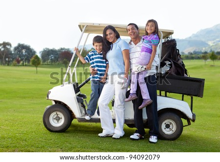 Beautiful family portrait with a golf cart at the course