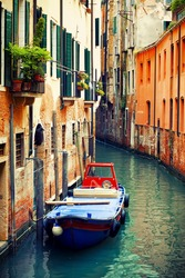 Beautiful famous canals in Venice with boat, Italy