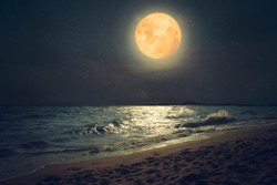 Beautiful fantasy tropical sea beach. Full moon (super moon) with star over seascape in night skies. Serenity nature background at nighttime. vintage and retro color filter style.