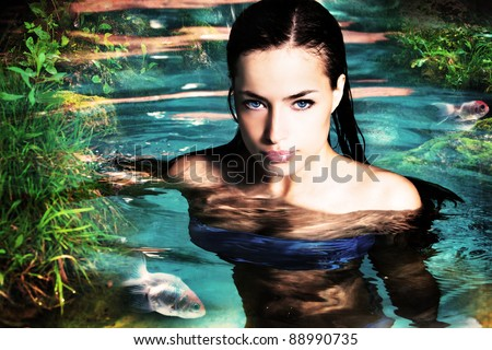 beautiful fantasy woman in water - stock photo