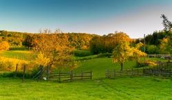 Beautiful farm in mountain village. Serbia, Europe. Colorful landscape in autumn. Season. Fields and meadows.