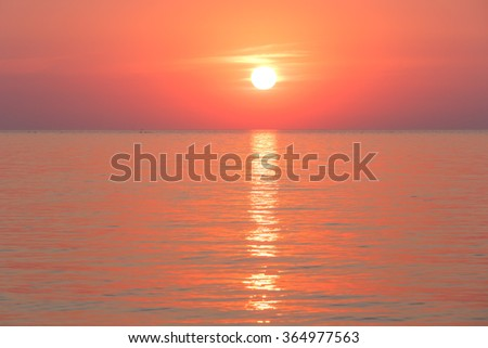 Beautiful fascinate morning sea view with sunrise and sun track on surface. #364977563