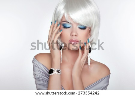 Beautiful fashion blond girl with bob hair. Makeup. Jewelry. Short straight hair Shine with health.