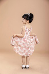 Beautiful fashion cute asian little girl wearing floral skirt shooting in studio