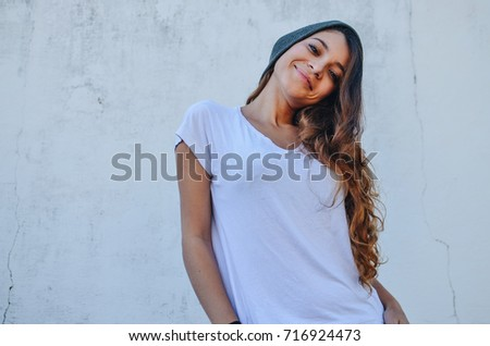Beautiful fashion girl model, wearing casual basic look, with white t-shirt and grey cap