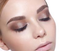 Beautiful Fashion Luxury Makeup, long eyelashes, perfect skin facial make-up. Beauty Blonde model woman holiday make up close up. Eyelash extensions, false eyelashes.