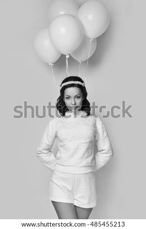 Beautiful fashion model girl with white balloons posing isolated on white background. #485455213