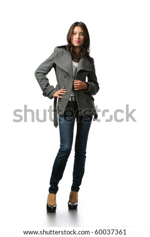 Beautiful fashion model in autumn clothes isolated on white background