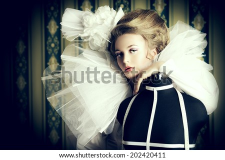 Beautiful fashion model in the refined white dress and mannequin. Vintage style. Art project. Haute Couture. #202420411
