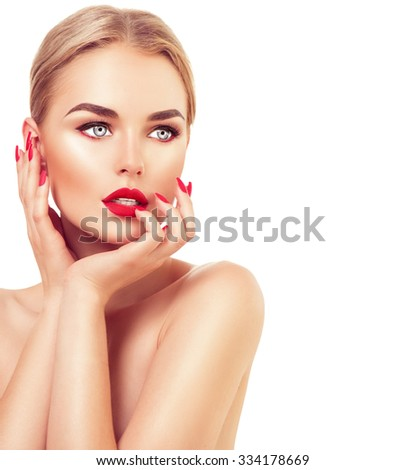 Stock Photo Beautiful fashion model Woman with blond hair, Red lipstick and nails. Portrait of glamour girl with bright makeup isolated on white background. Beauty female face close up with perfect make up