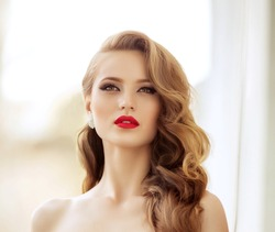 Beautiful fashion model Woman with hair, Red lipstick . Portrait of glamour girl with bright makeup. Beauty female face close up with perfect make up