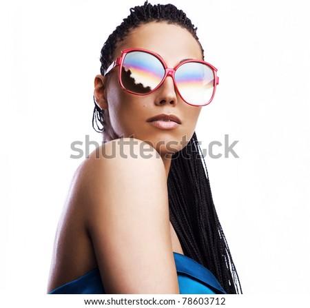beautiful fashion mulatto woman wearing sunglasses over a white background.