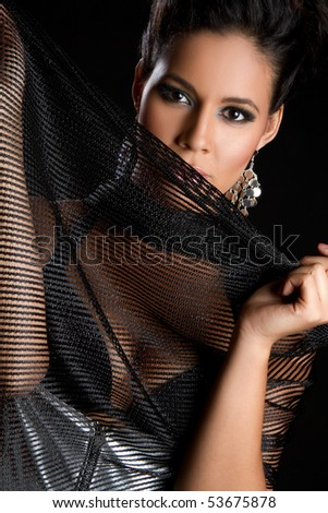 Beautiful fashion woman holding scarf