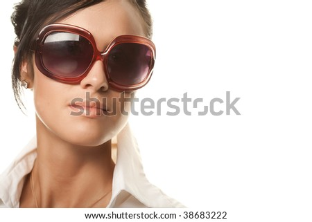 beautiful fashion woman wearing sunglasses over a white background - stock photo