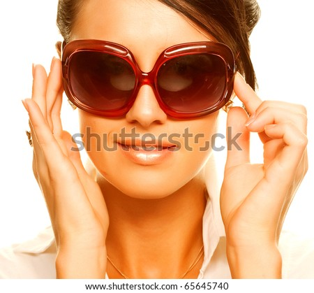 beautiful fashion woman wearing sunglasses over a white background
