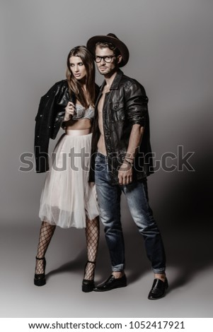 Beautiful fashionable couple dressed in casual clothes. Beauty, fashion.  #1052417921