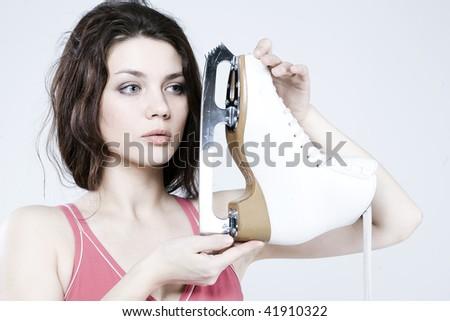beautiful fashionable girl with skates