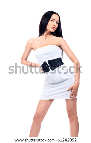 Beautiful fashionable woman in a white dress. Isolated over white background.