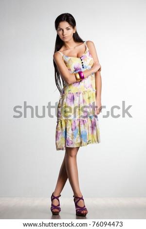 beautiful fashionable woman in dress