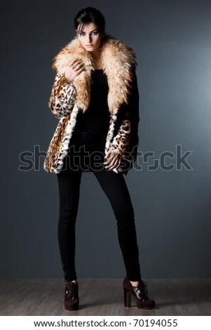 beautiful fashionable woman in fur coat