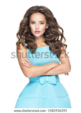 Beautiful fashionable woman with long  hair in blue dress. Attractive fashion model posing on white background. #1482936395